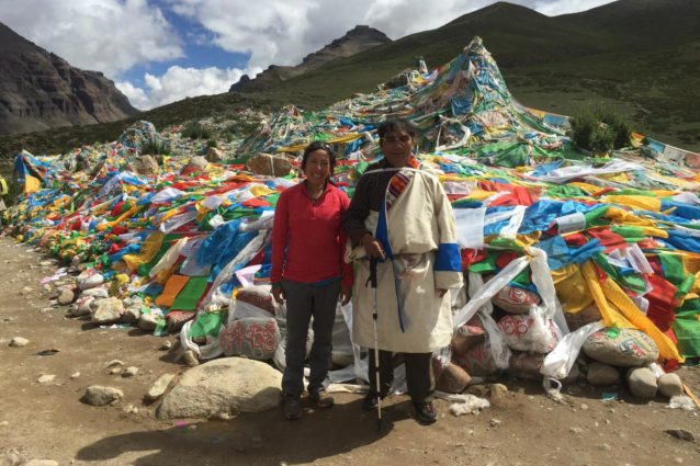 First prostration point (lcags tshal sgang) around the Kailash kora. This pilgrim, who came with his family from the Ngari prefectural seat for circumambulation over the weekend, decided to crash my photograph (Source: Emily Yeh/University of Colorado).