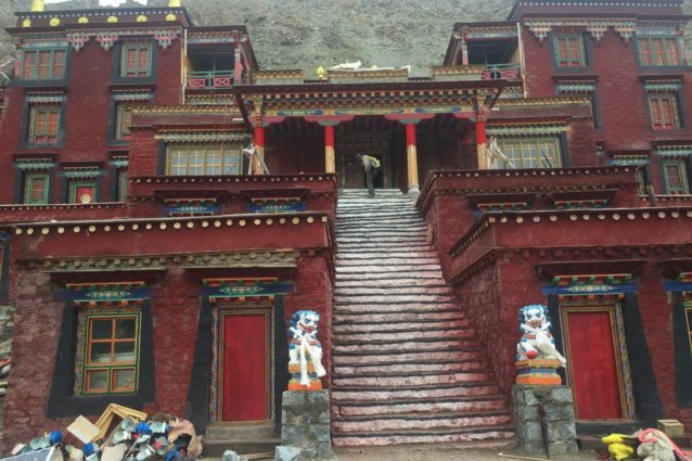 Drira Phug ('bri rwa phug) means 'cave of the female yak ('bri) horn.' Gyalwa Gotsangpa, who 'opened' the circumambulation route around Kailash in the thirteenth century, was led by Sengdongma, the manifestion of a goddess of Dzogchen, in the form of a female yak to a cave at the place where the monastery now stands, where it put its horns onto and then disappeared into a rock. He meditated in the cave here for 3 years, eating only the food of gods and dakinis, rather than human food. The cave around which the monastery is built is said to have a history of 2500 years. Yeshe Tsogyal, Guru Rinpoche's consort, meditated here in the 8th century, in the 11th century, Marpa ordered Milarepa to meditate in this cave, and Shabkar also meditated here. The monastery was completely destroyed during the Cultural Revolution. In 1996, the main lama, Tenzin Namgyal, began to rebuild a small part of the monastery. In 2013, the monastery received permission to rebuild more of it, and when we were there, there was quite a lot of activity, with a number of interior rooms being painted (Source: Emily Yeh/University of Colorado).