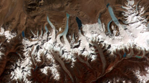 Retreating glaciers, such as these in the Himalayas, are a popular symbol of climate change (Source: NASA/Creative Commons).