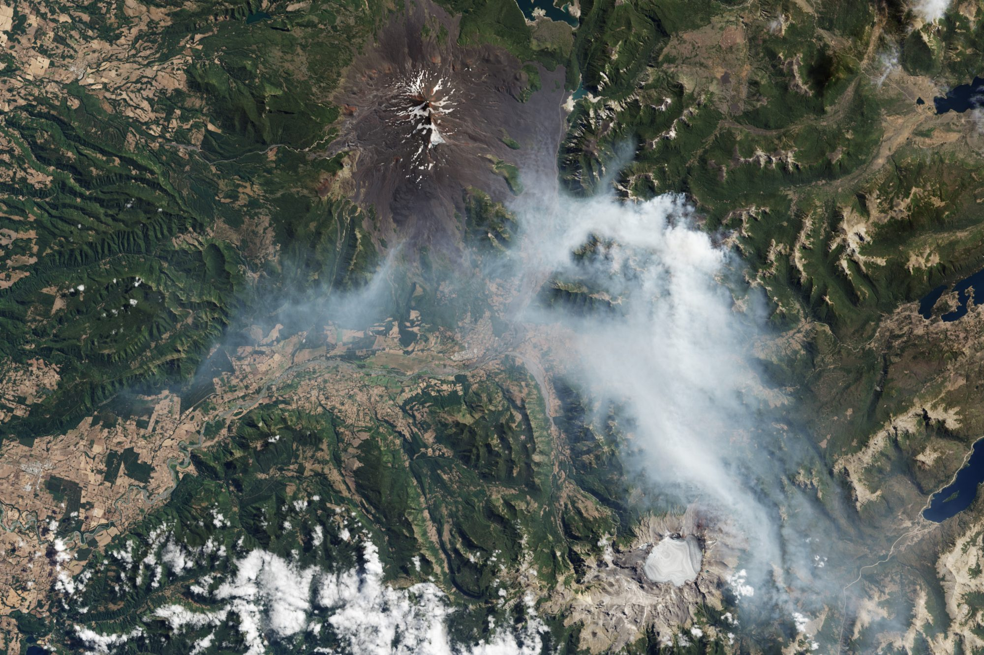 High winds and unusually warm weather are fueling damaging wildfires in southern Chile. The Operational Land Imager (OLI) on Landsat 8 acquired this image of smoke produced by a fire southeast of Llaima volcano on March 17, 2015 (Source: Jesse Allen/NASA).