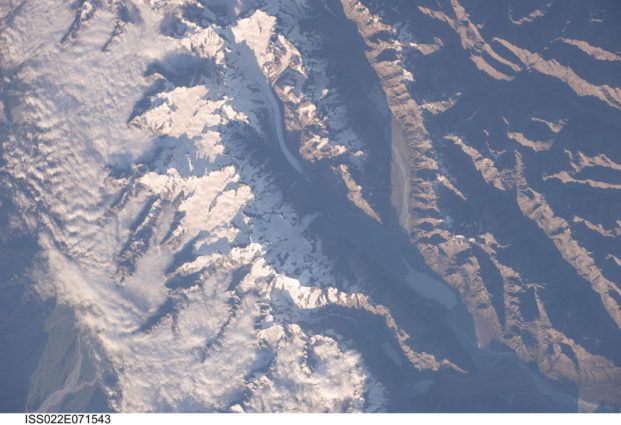 An image of New Zealand's Tasman Glacier and portions of the Southern Alps under snowfall taken by an astronaut aboard the International Space Station in 2010 (Source: NASA).