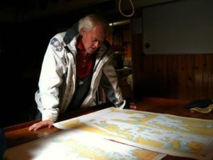 David Buckland deciding on the sailing route. (Source: Cape Farewell).