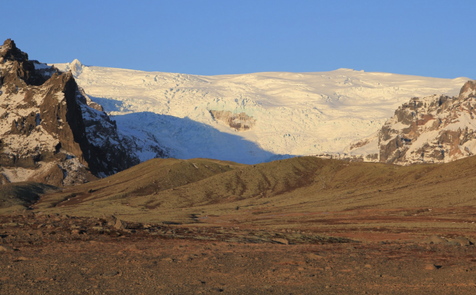 Photo of ÖRÆFAJÖKULL from the ground showing its extensive glacial coverage.