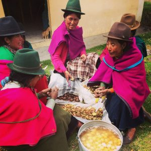 Photo of women preparing a potato soup in Ecuador.