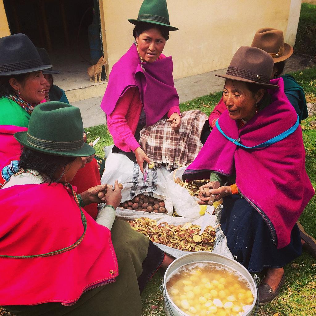 Photo of women preparing a potato soup in Ecuador.
