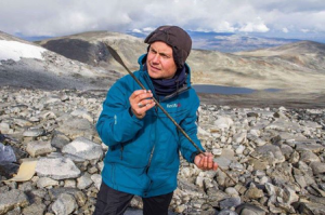 One of Pilø's team members finding an remarkably well-preserved arrow near a melting ice patch at 1900m in Jotunheimen