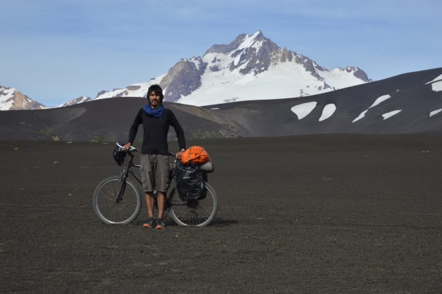Photo of Marcos Cole in front of the Sierra Velluda volcano