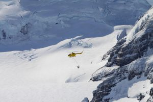Photo of Helicopter with poisoned bait flying over a glacier