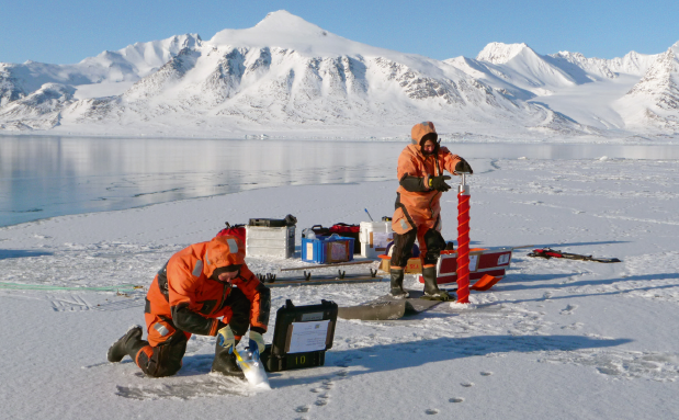 Researchers collecting samples from sea ice from Kongsfjorden, Svalbard (Source: S. Gerland)