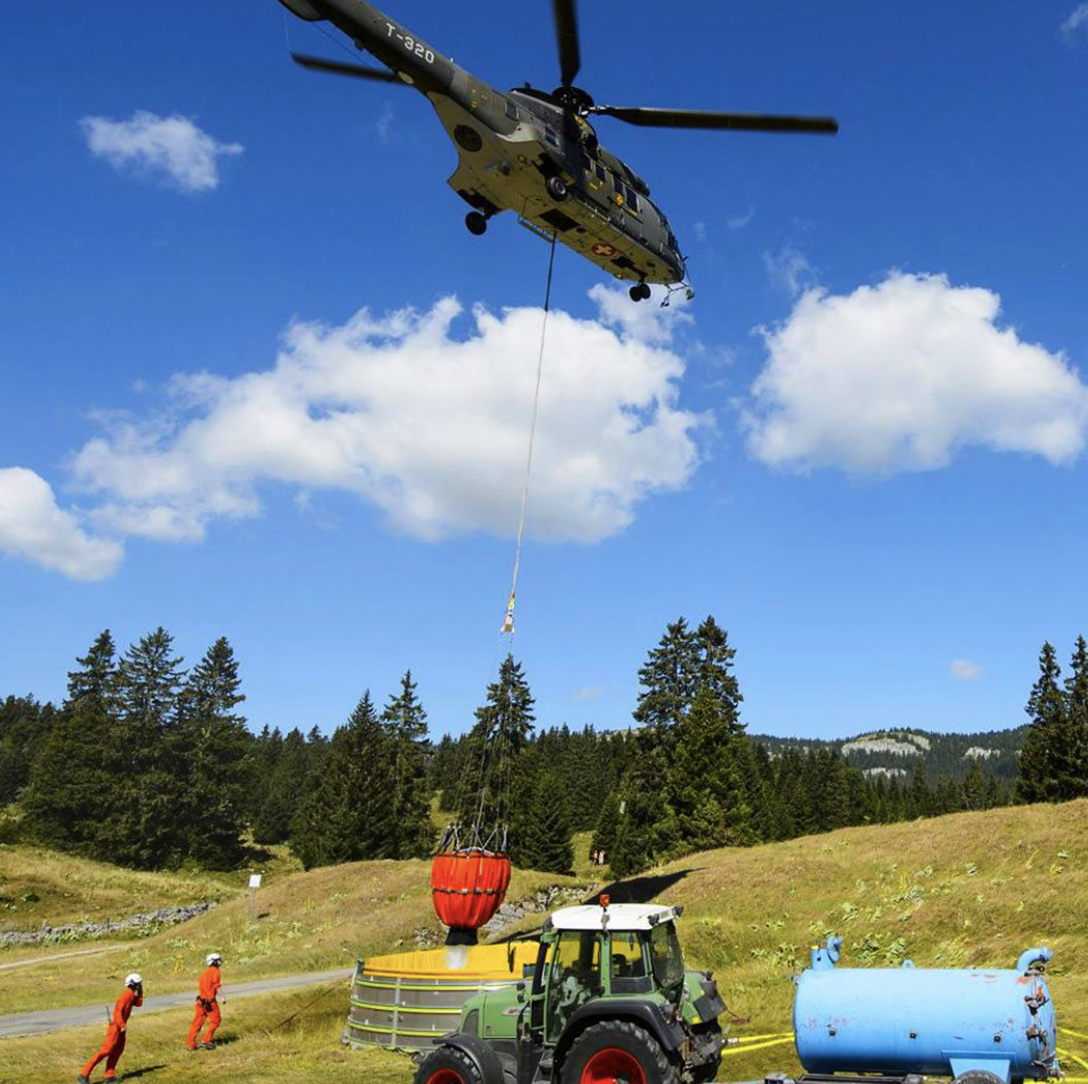 Photo of a helicopter dropping water