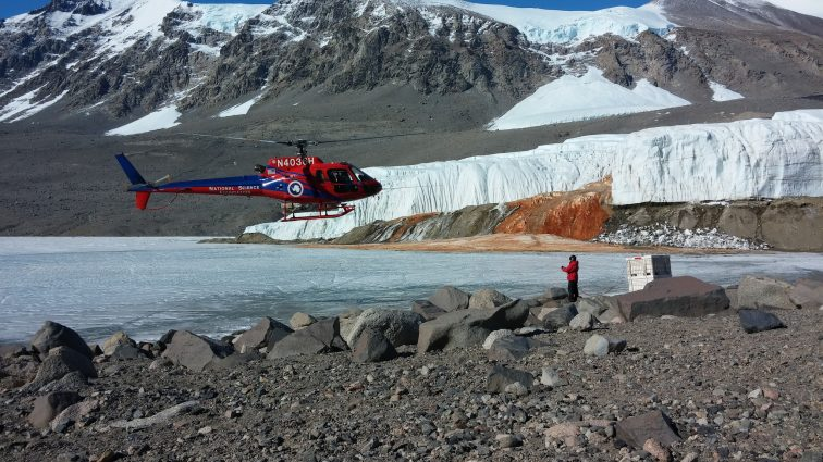 United States National Science Foundation's helicopter at Blood Falls on GlacierHub
